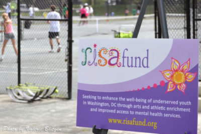 Risa Fund sign at tennis event
